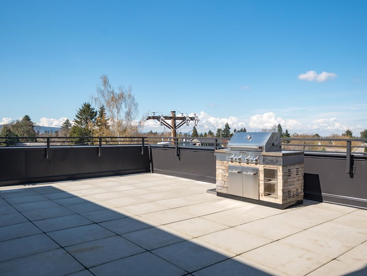 Slogan Apartments | Roof top BBQ Area