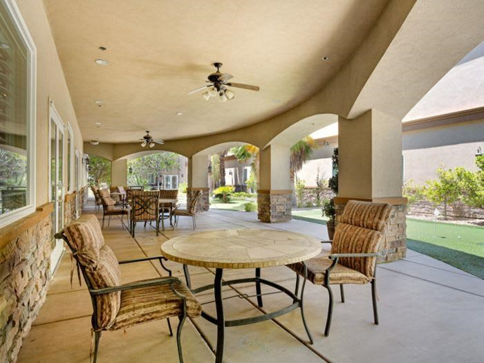Shady outside patio with garden view at Pacifica Senior Living San Martin in Las Vegas, NV