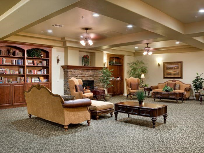 luxurious living room with fireplace at Pacifica Senior Living San Martin in Las Vegas, NV