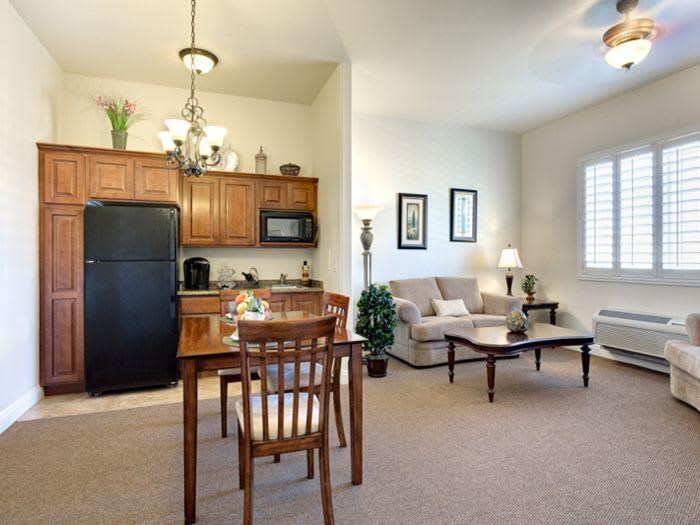 Natural Wood kitchen and living room combo at Pacifica Senior Living San Martin in Las Vegas, NV