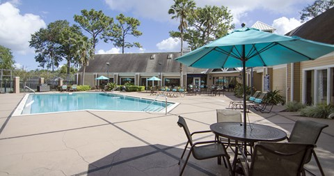 Relax poolside at The Park at Laurel Oaks