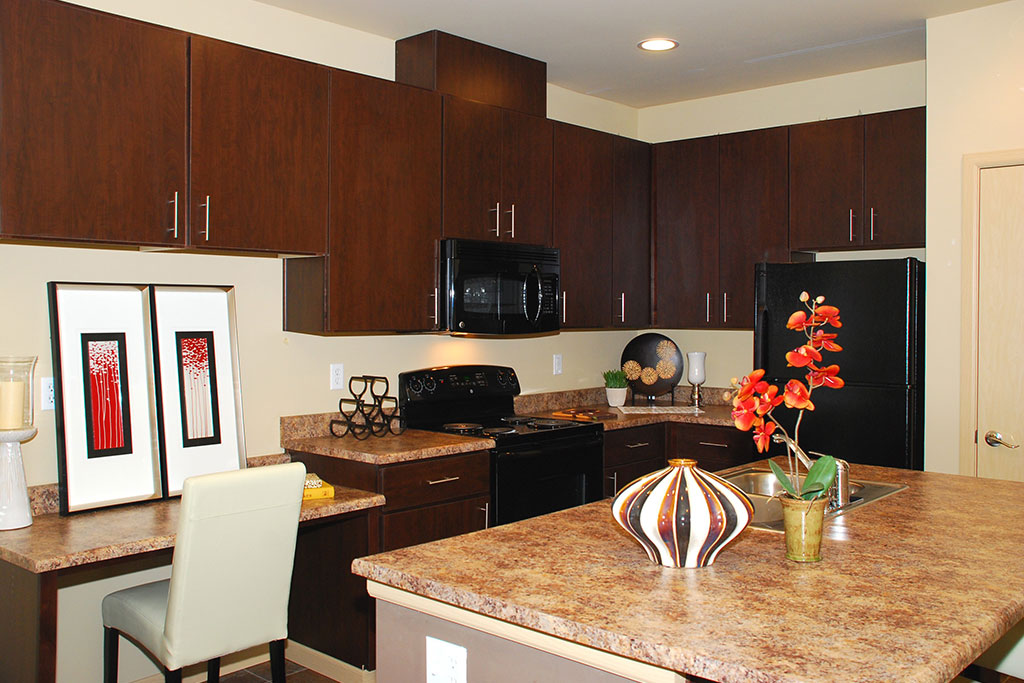 Updated Kitchen With Black Appliances at Yauger Park Villas, Olympia, 98502