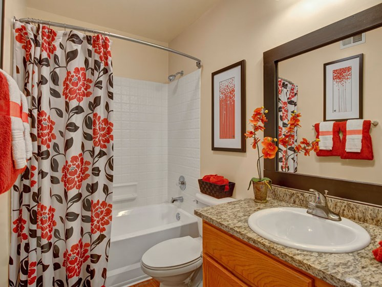 Apartment bathroom with vanity and wood floors