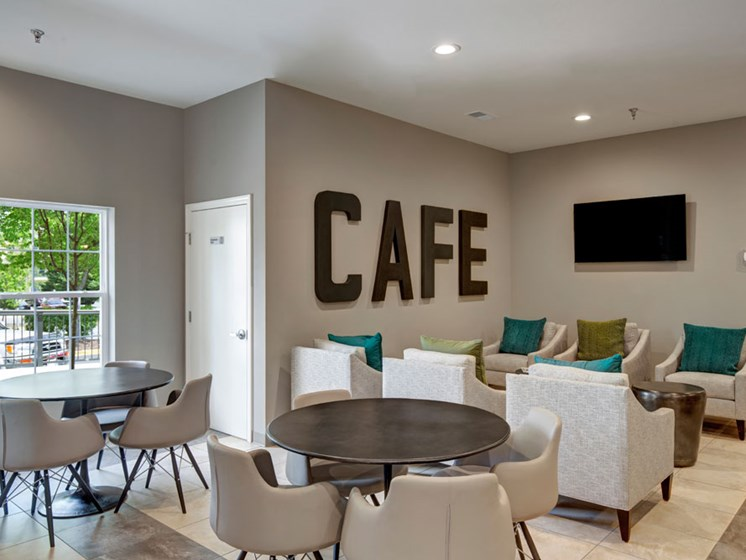 Common area lounge with multiple seating areas and TV