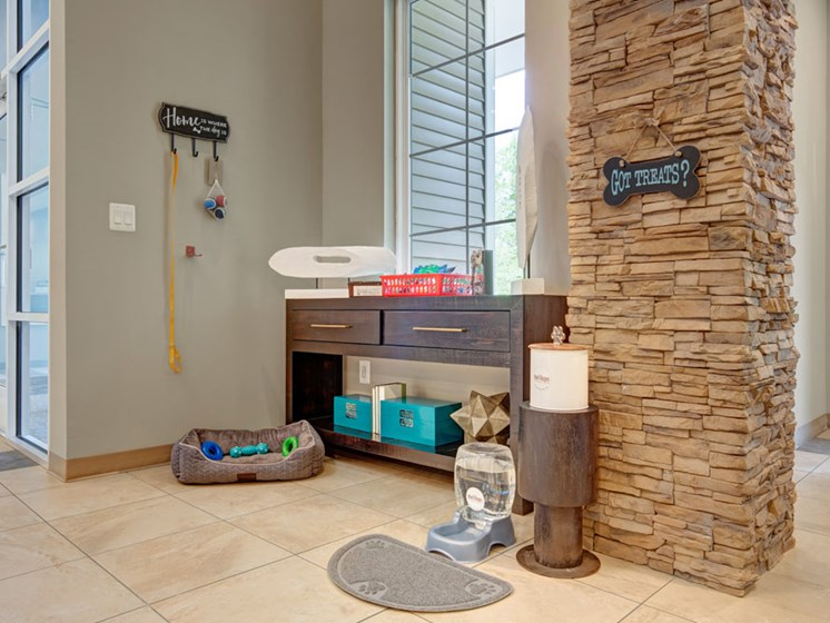 Clubhouse with pet friendly display including leashes and dog bed
