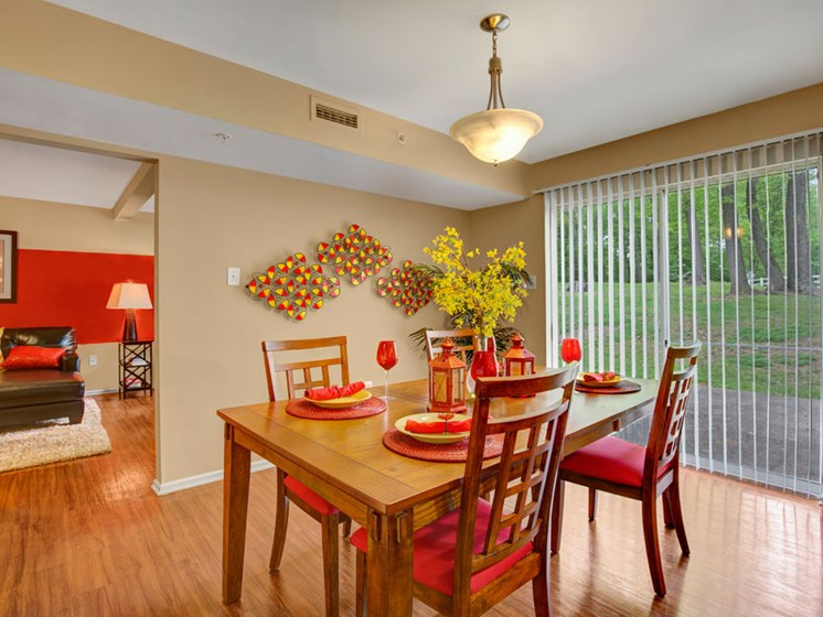 Furnished apartment dining room with dining set and large window