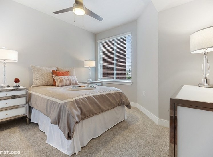 Large Modern Bedroom With Plenty of Natural Light at the Monarch Apartments in Des Plaines