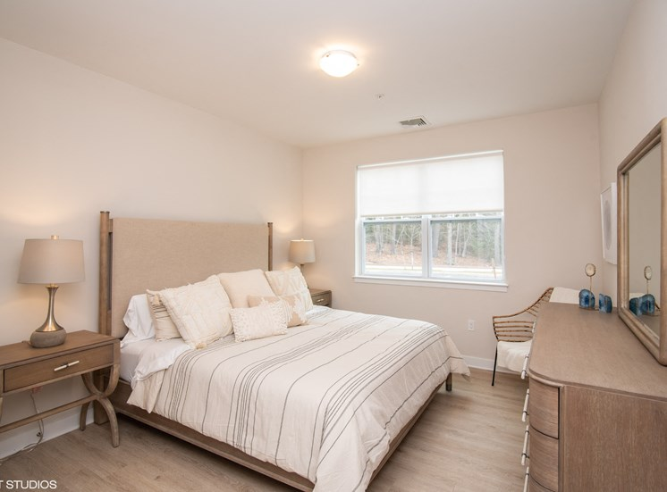 Large Bedroom Spaces with Modern Furniture at the Preserve at Great Pond Apartments in Windsor, CT