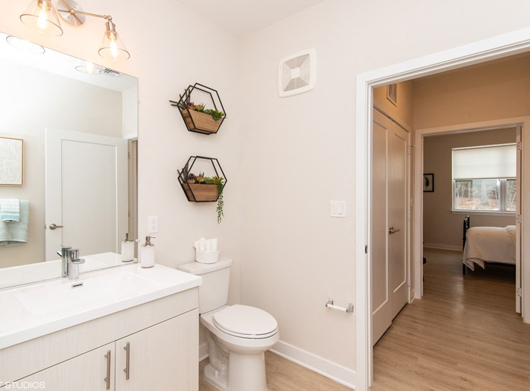 Large Bathroom Opening to the Bedroom at the Preserve at Great Pond Apartments in Windsor, CT