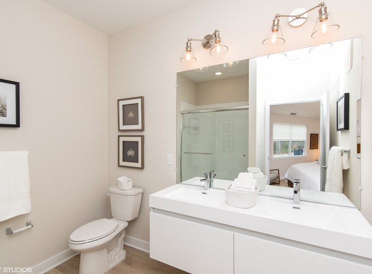 Bright Bathroom with Bathtub, Mirror, Sink, and Toilet in Our Apartments in Windsor, CT