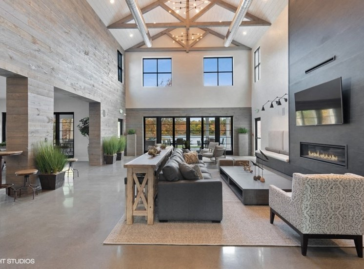 Breathtaking Community Space with a Flat Screen Television, Indoor Fireplace, and Soaring Ceilings