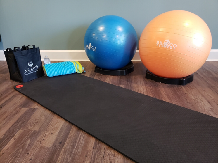 yoga mat and exercise balls in fitness center