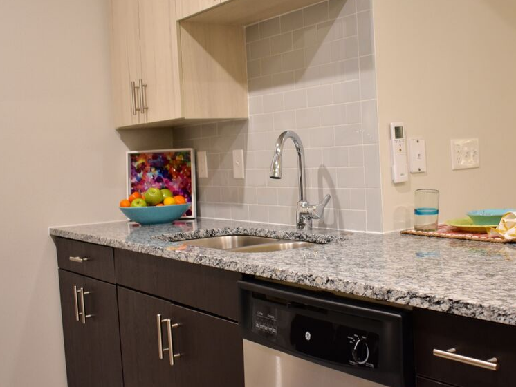 kitchen sink and granite counter tops