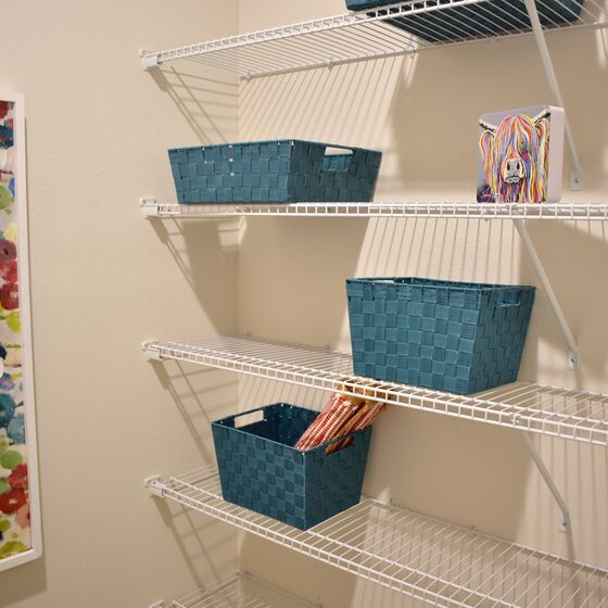 white shelves with baskets for storage