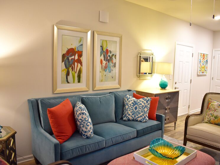 living room couch with bright pillows