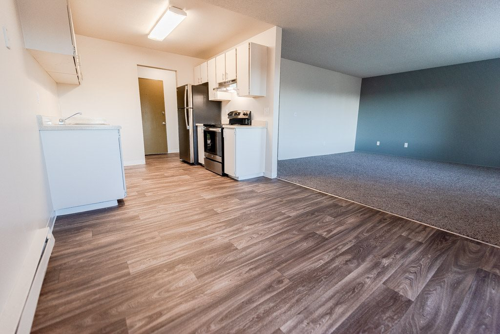 Lakewood Apartments - Arbor Pointe Apartments - Dining Room, Kitchen, Entryway, and Living Room