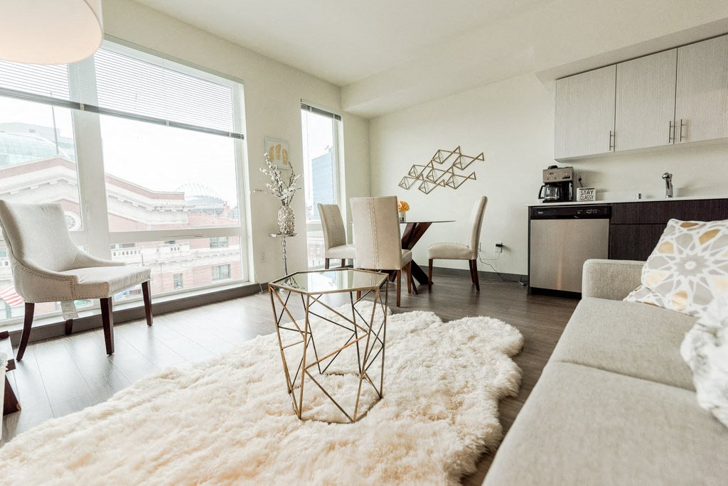 Seattle Apartments - Icon Apartments - Living Room, Dining Room, and Kitchen