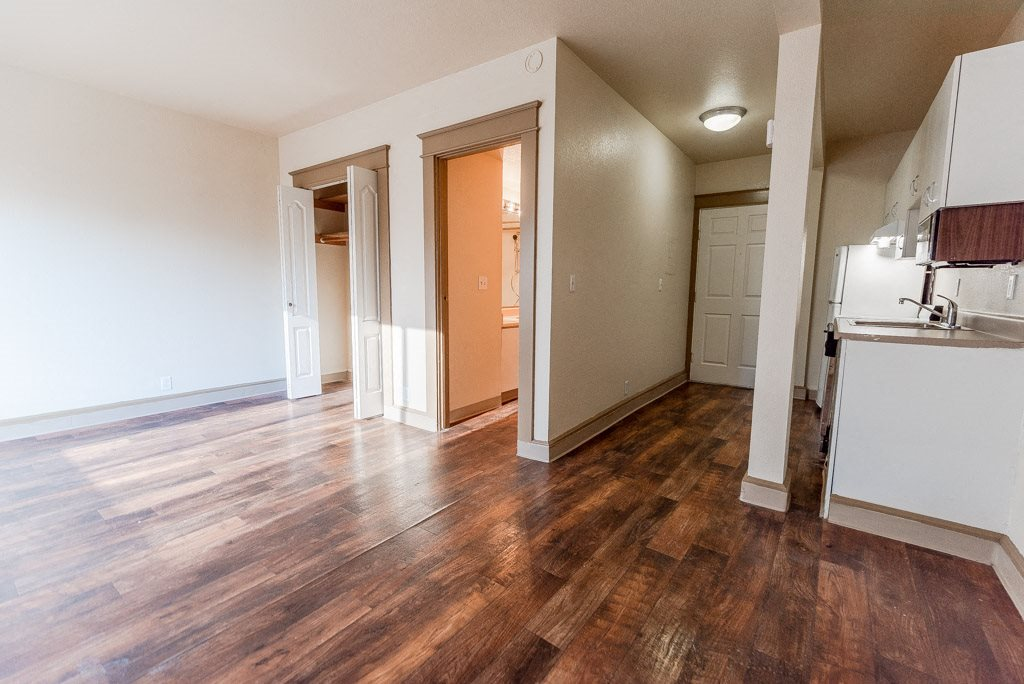 Seattle Apartments - Zindorf Apartments - Studio, Closet, Bathroom, Entryway, and Kitchen