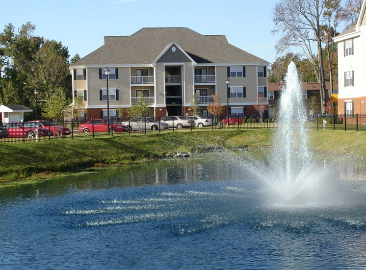 fountain and building exterior at Whispering Oaks Apartment Homes in Portsmouth, VA