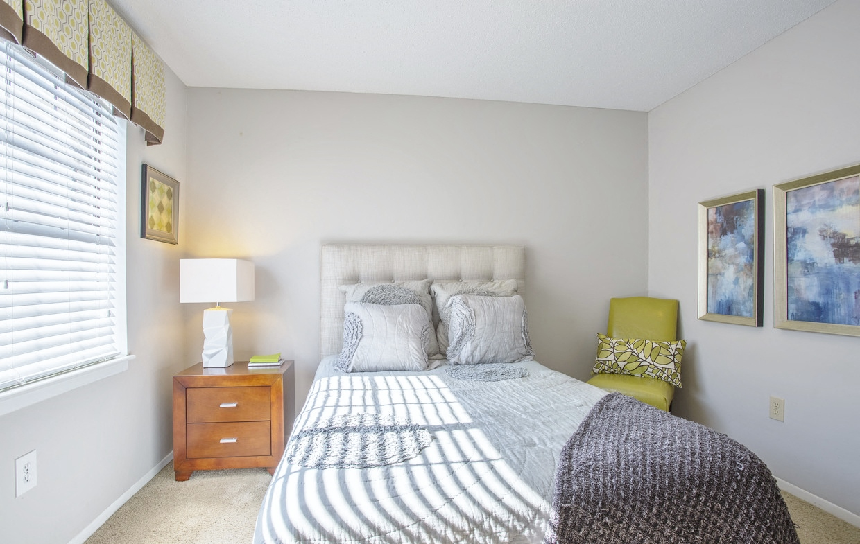 Bedroom at Chimneys of Greenville apartment homes in Taylors, SC