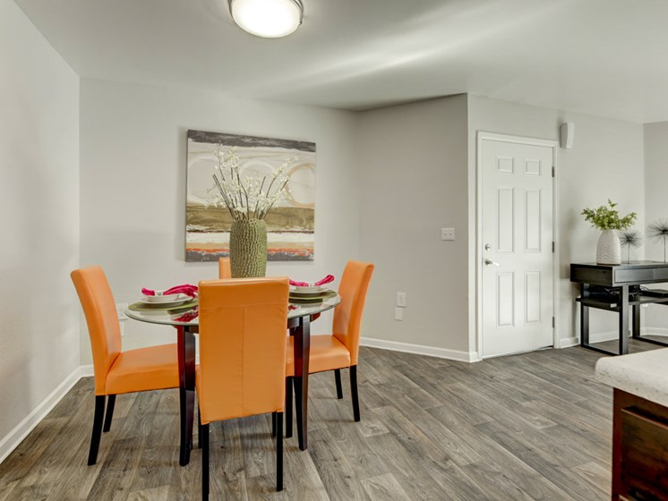 Dining Area with orange chair and decorative floral arrangements
