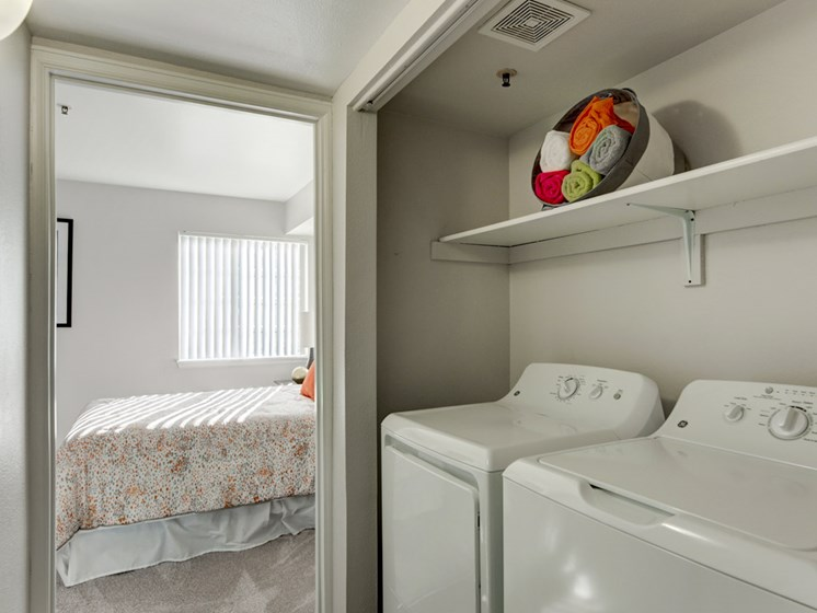 Laundry area with washer and dryer for apartments in denver colorado