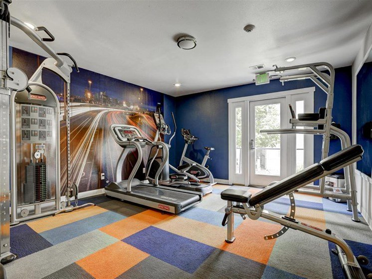 Gym with modern equipment area for residents at ascent apartments