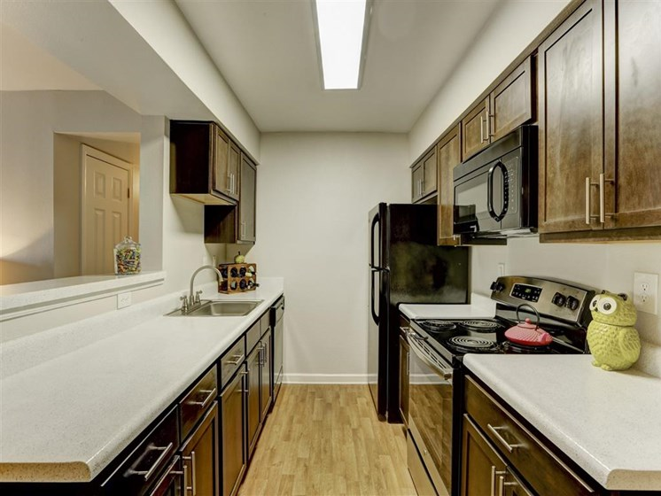 Kitchen with wooden cabinetry at apartment unit in denver colorado