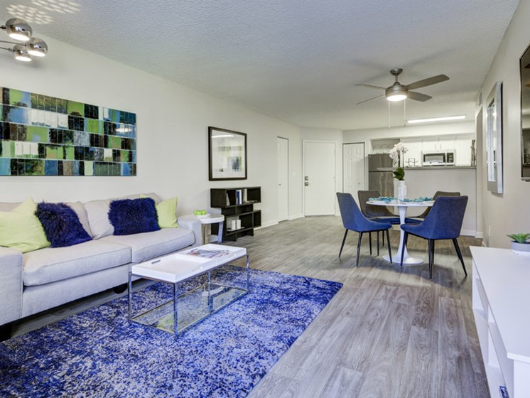 living room with view of kitchen at apartment complex in lakewood co