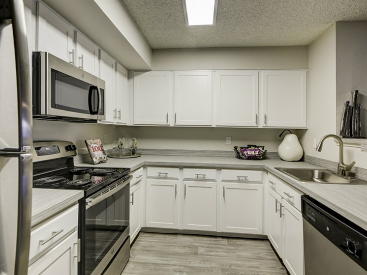 white kitchen cabinetry at apartment unit in lakewood colorado