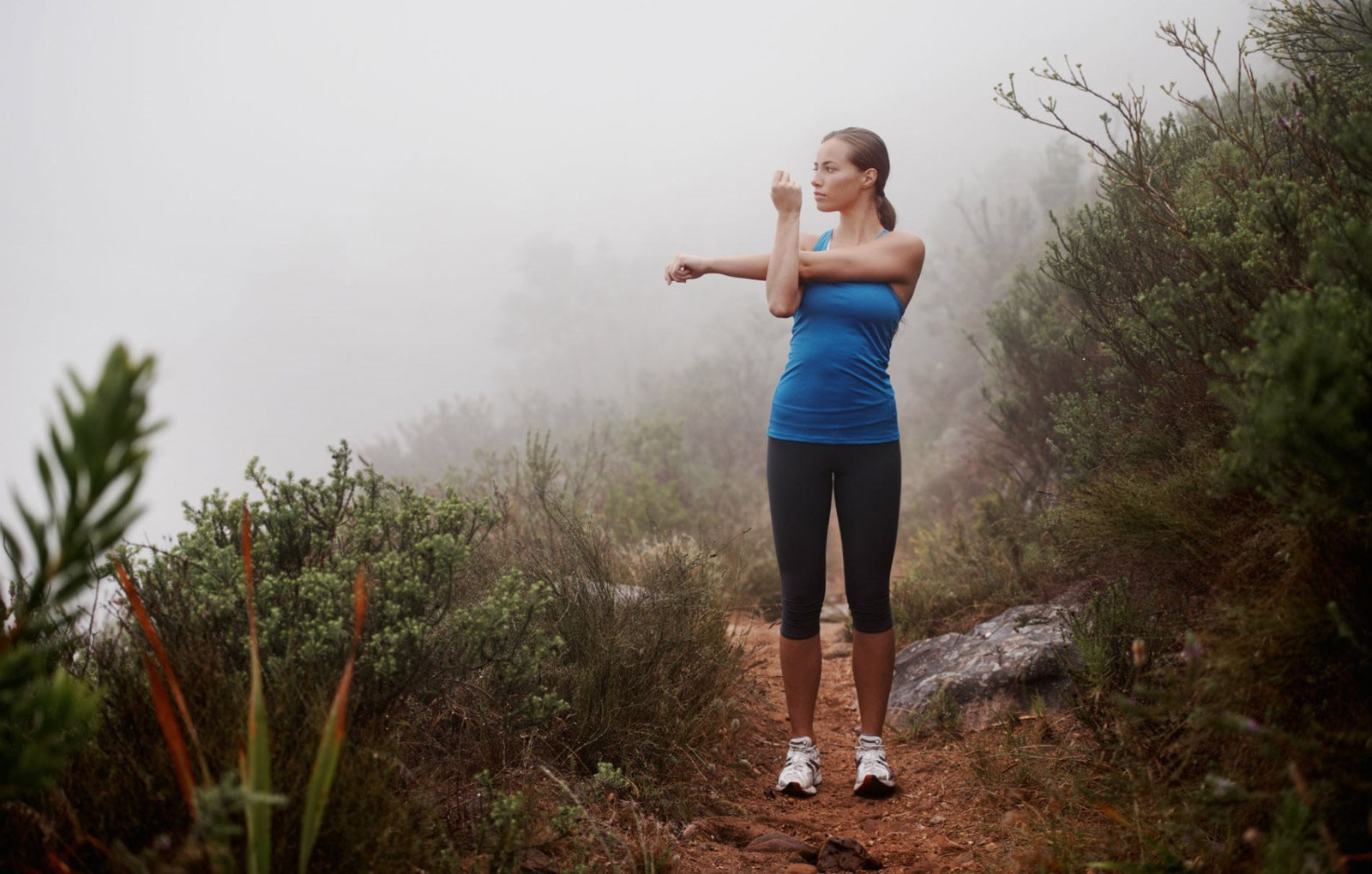 woman stretching on trail in lakewood colorado