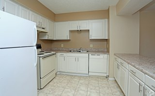 Pecan Acres Apartments in Lake Charles kitchen with fridge