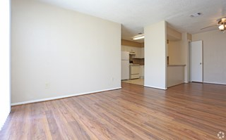 Pecan Acres Apartments in Lake Charles hardwood-styled floors and ceiling fans