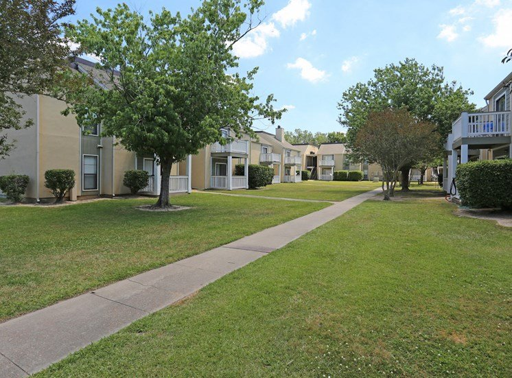 Pecan Acres Apartments in Lake Charles shade trees and trim grass