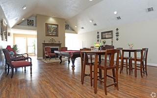Pecan Acres Apartments in Lake Charles resident clubhouse with seating and billiards