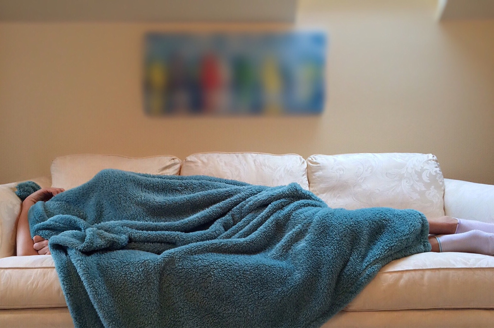 Sleeping with covers over head