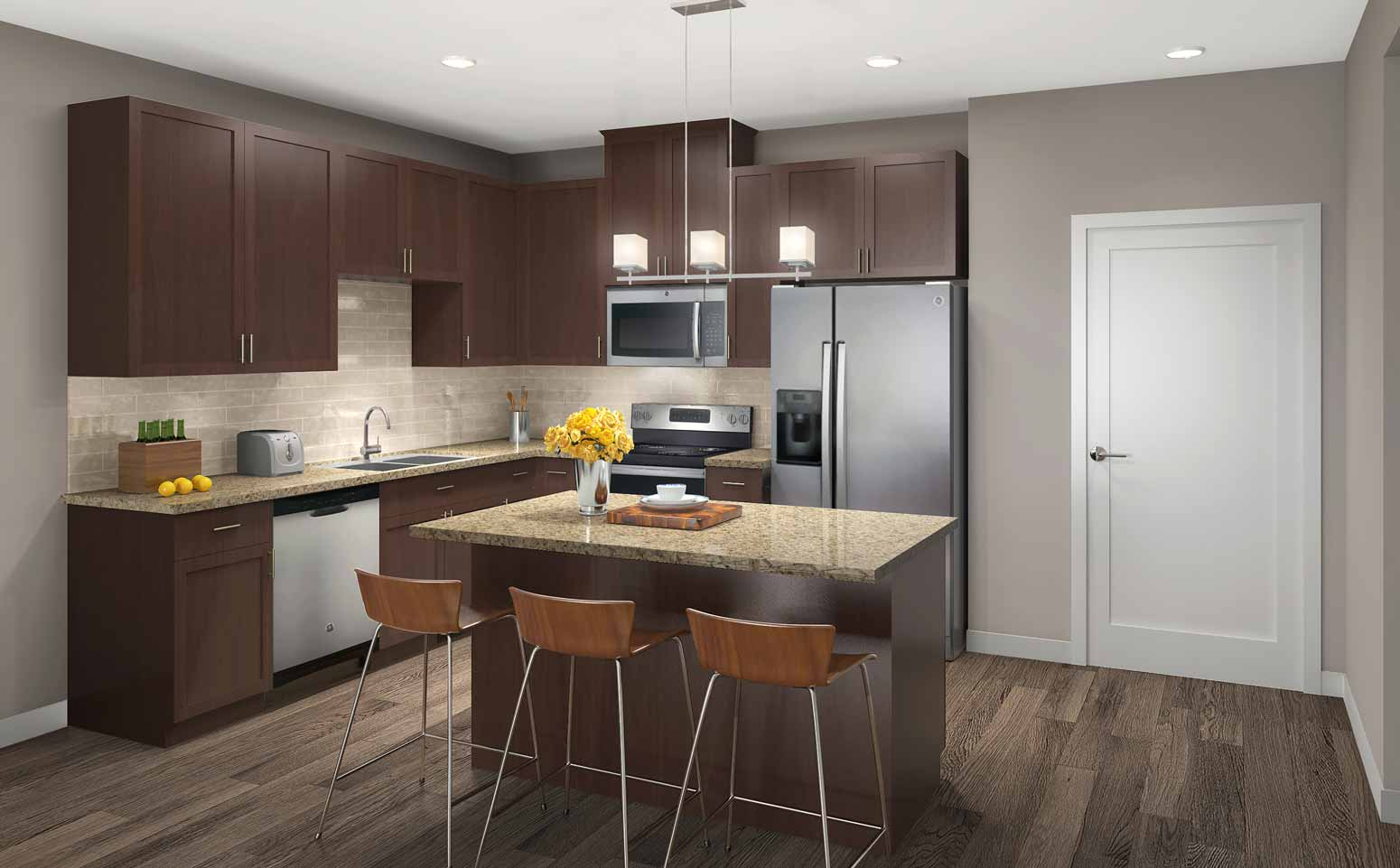 Woodland design scheme features warm, cherry wood cabinetry and light granite countertops.