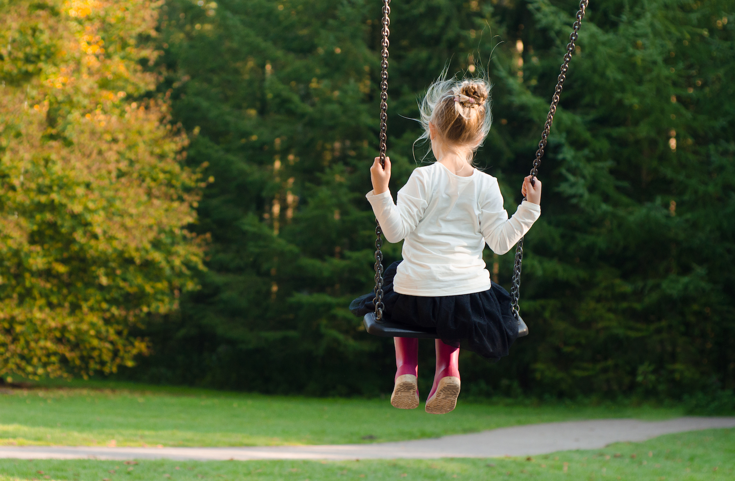 Child swinging at a park