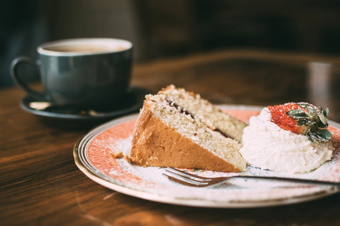 Cake, ice cream and coffee on a wooden table