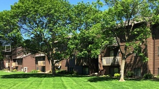 Parkside Manor Apartments - Rental Complex in Coralville, IA Courtyard,  Green Grass,  Trees