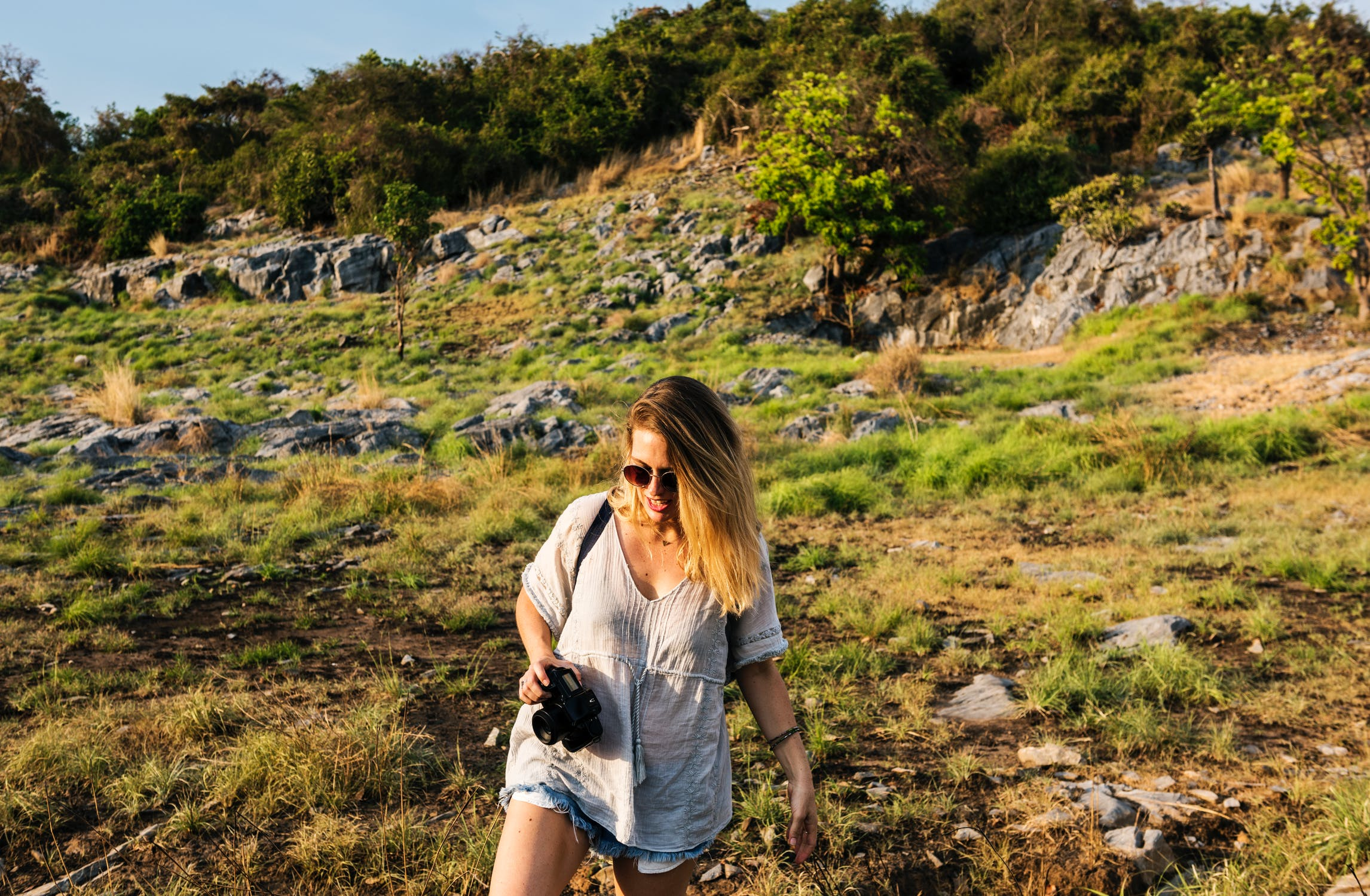 Girl hiking with a camera