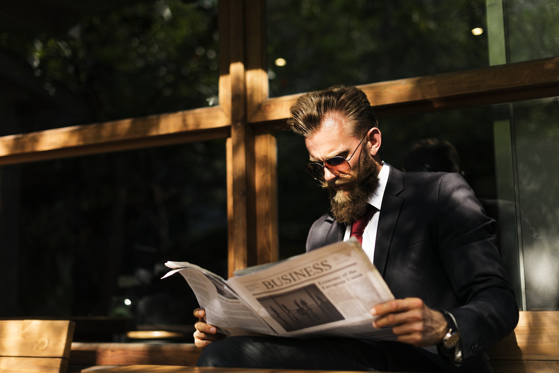 Generation Z Male looking at Newspaper